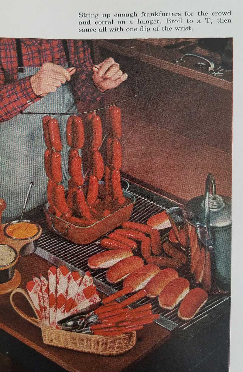Hot dogs on a coat hanger for easy saucing.