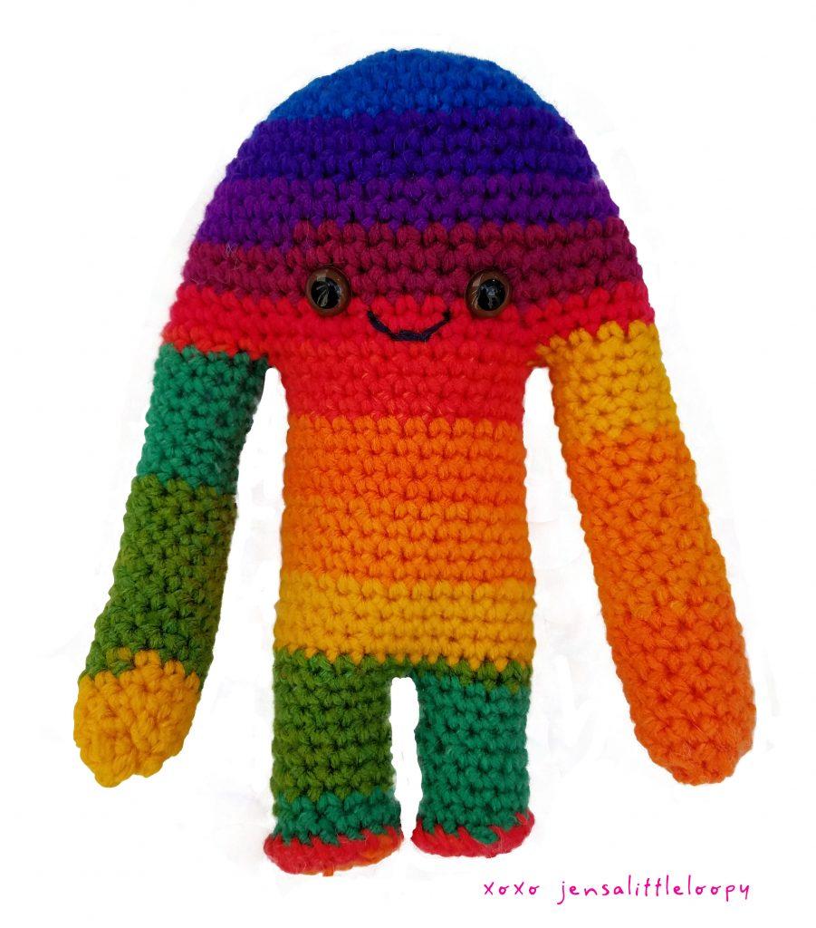 A rainbow striped Hugamonster crocheted by Jensalittleloopy.